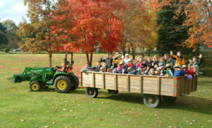 Participants on a tractor pulled wagon