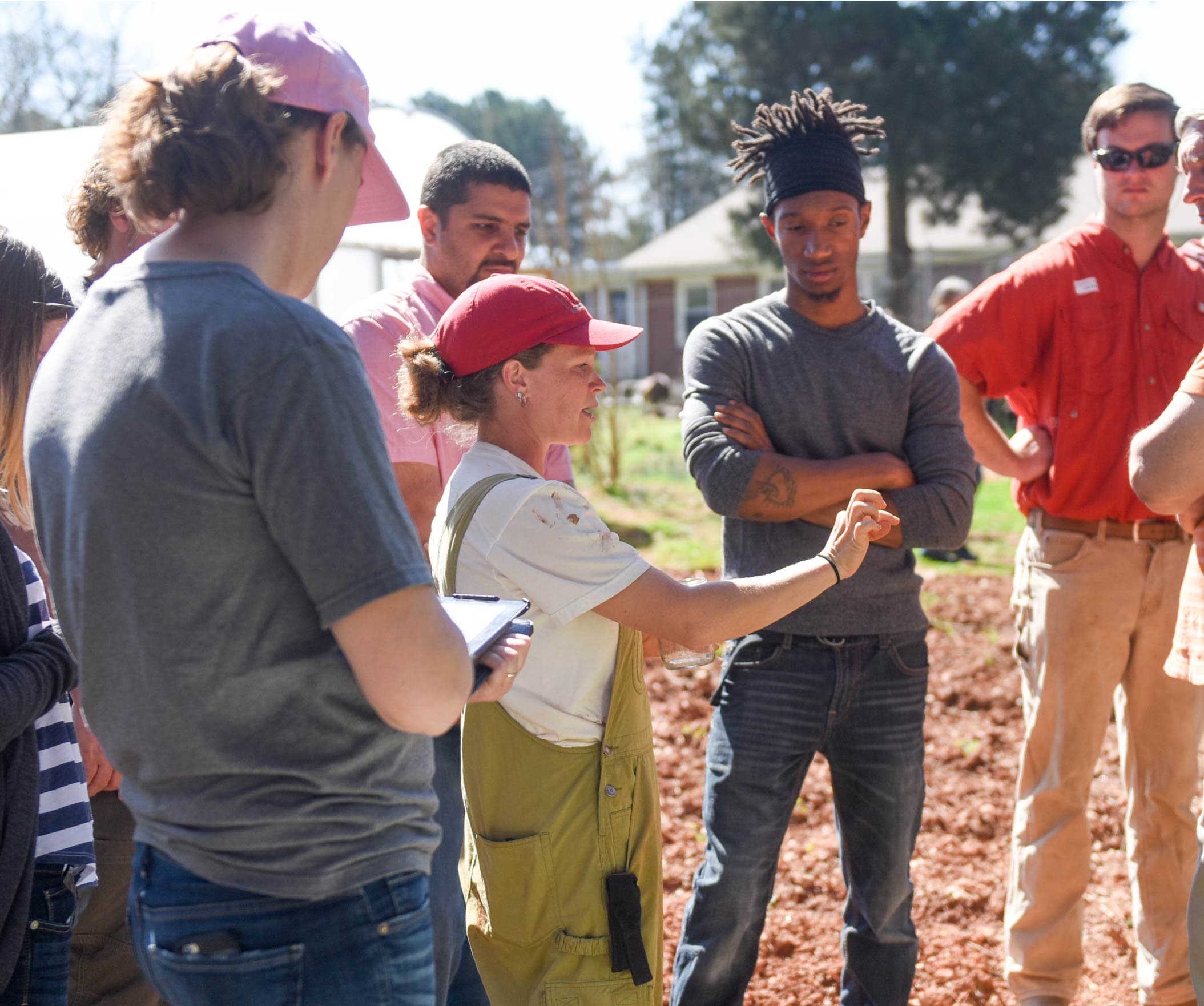 person teaching farm school participants
